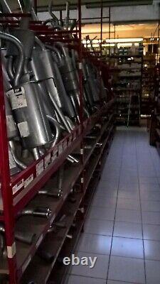 A SAISIR LOT d'env 1200 silencieux/tubes echappement neufs pour env 3.50eur/1pce